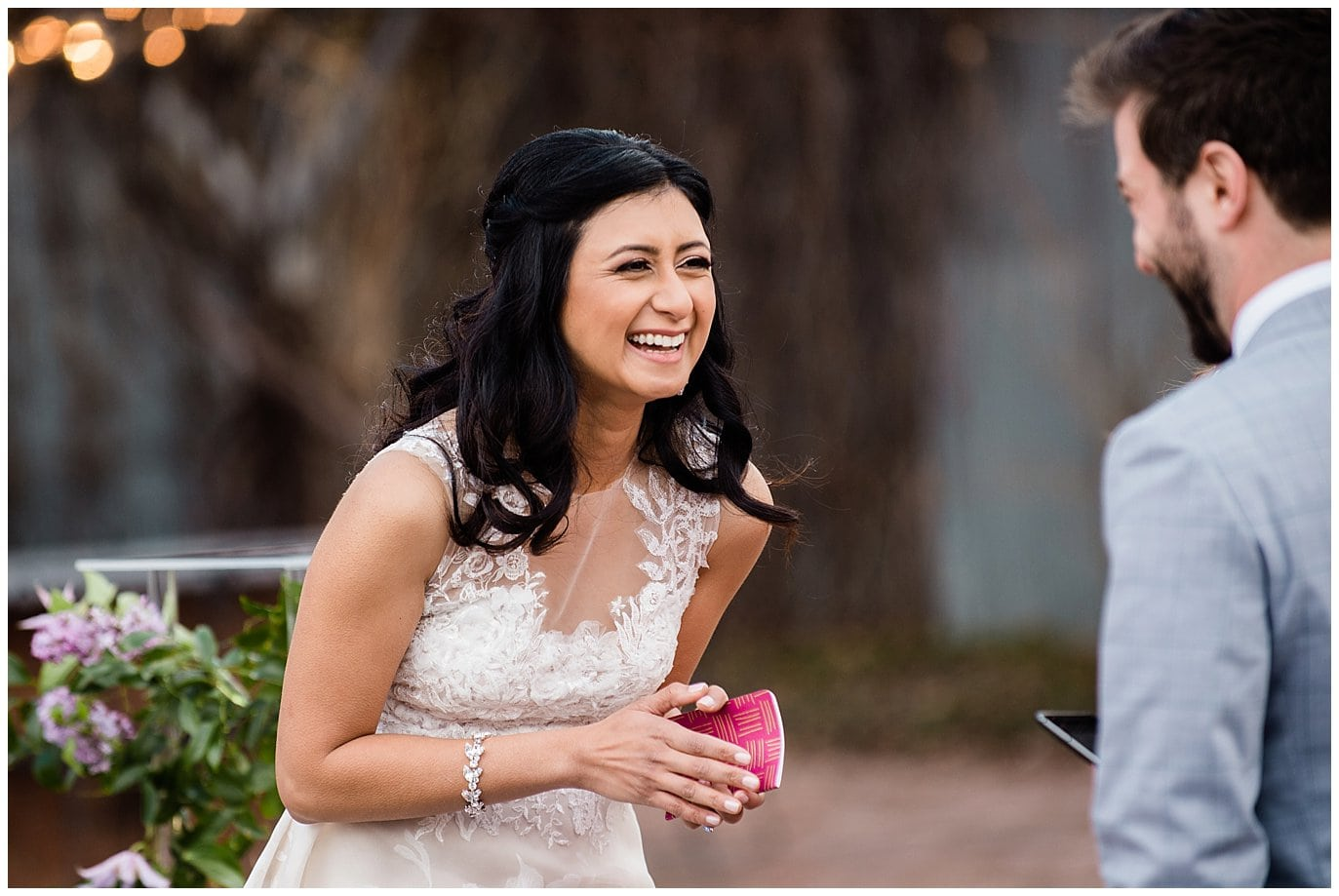 bride laughing during vows by Blanc Wedding Photographer Jennie Crate