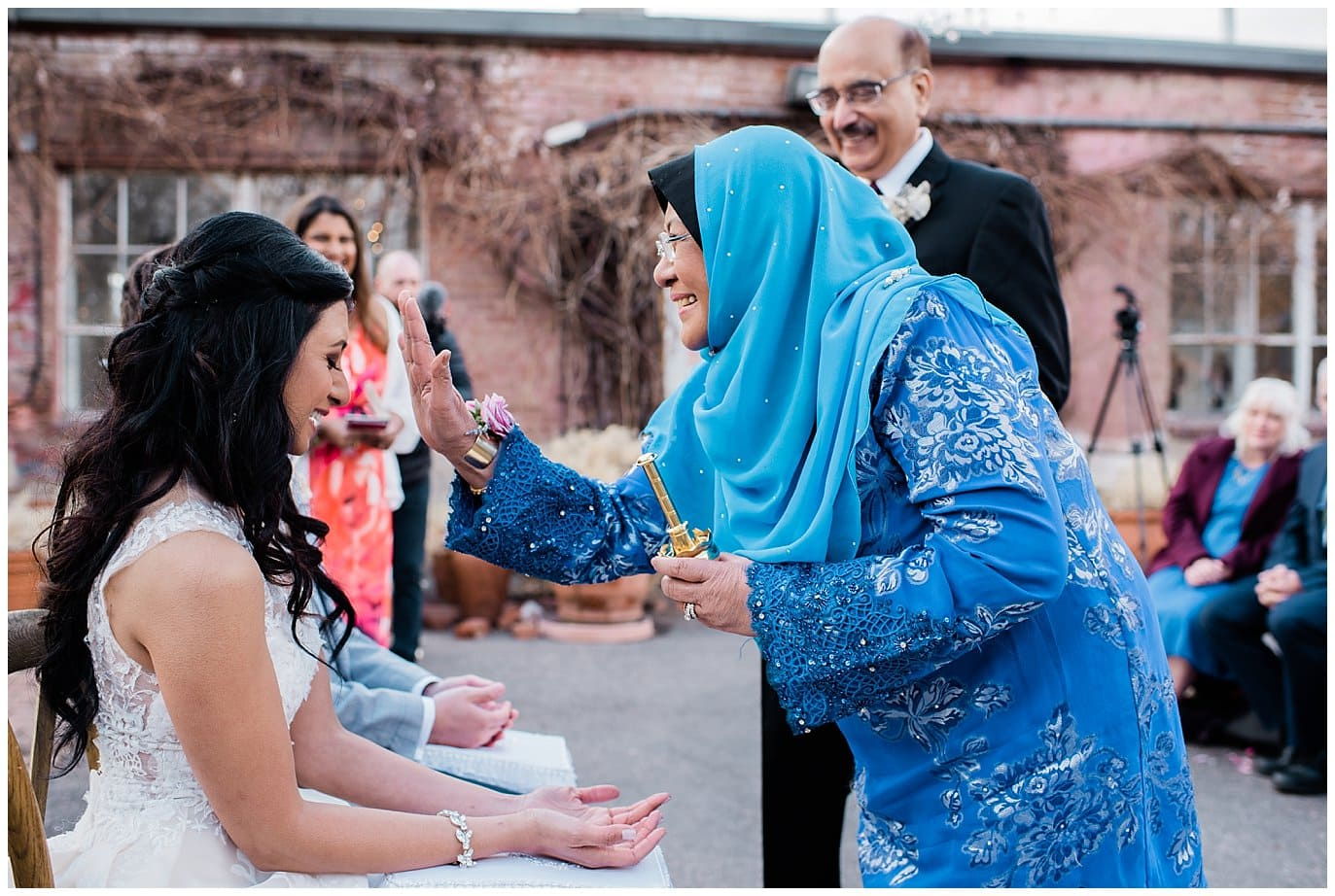 rose water blessing by bride's mother wedding by Blanc Wedding Photographer Jennie Crate