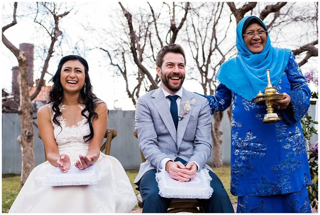 rose water blessing Malaysian American wedding at blanc Denver wedding by Denver wedding photographer Jennie Crate