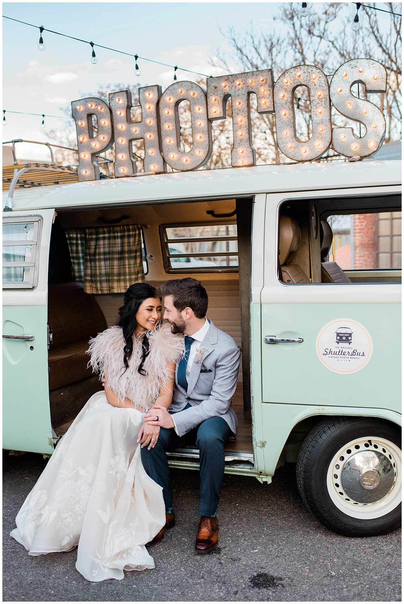 bride and groom in shutter bus photo booth at Blanc wedding by Denver Wedding Photographer Jennie Crate