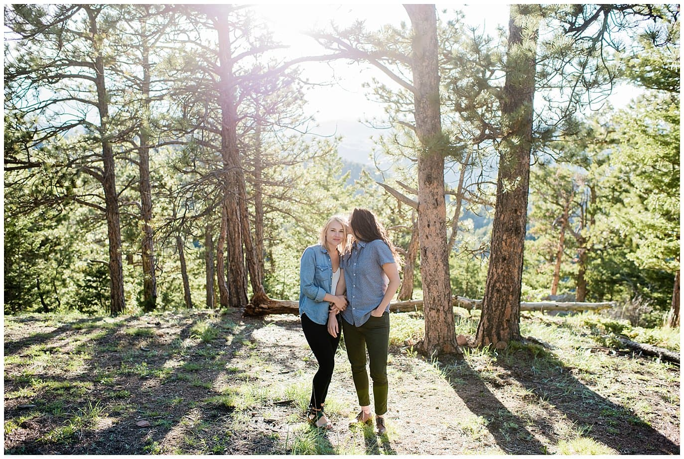 couple in colorado forest engagement photo