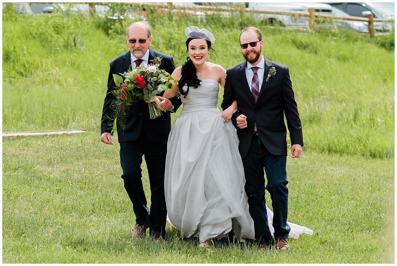 Bride walking down aisle for outdoor colorado wedding photo