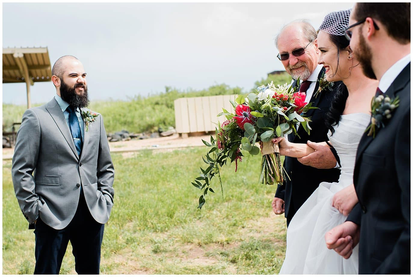 groom seeing bride for first time at wedding photo