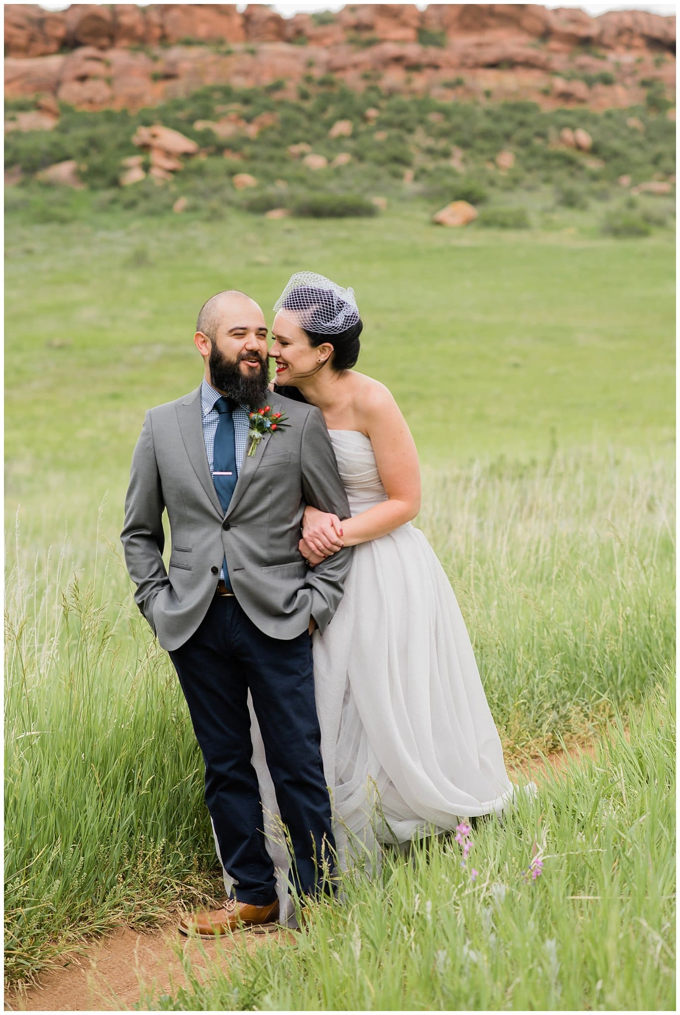 bride and groom in field in Fort Collins photo