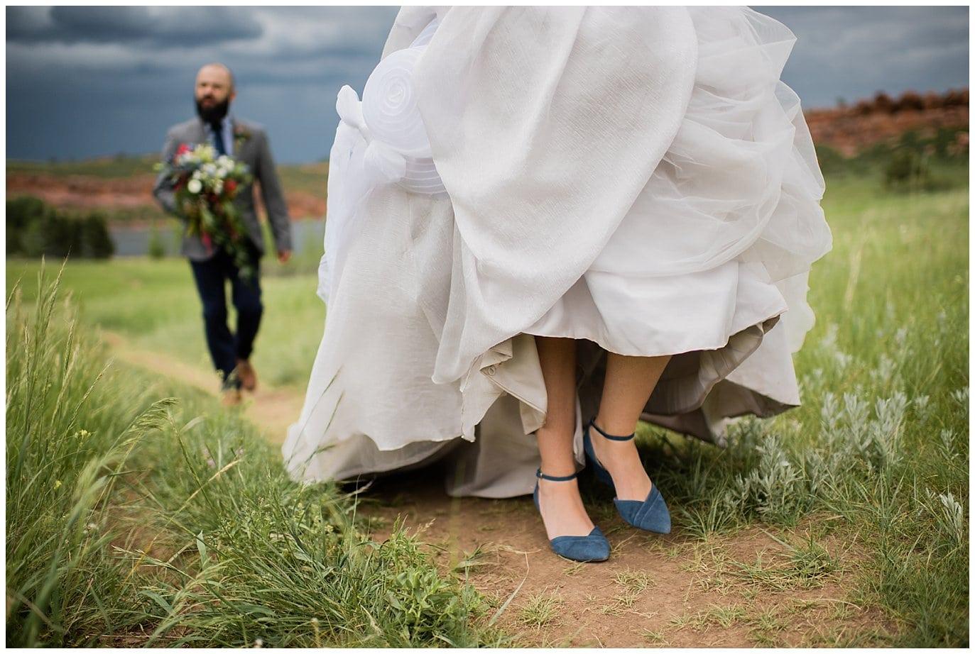 bride in grey dress with navy heels photo
