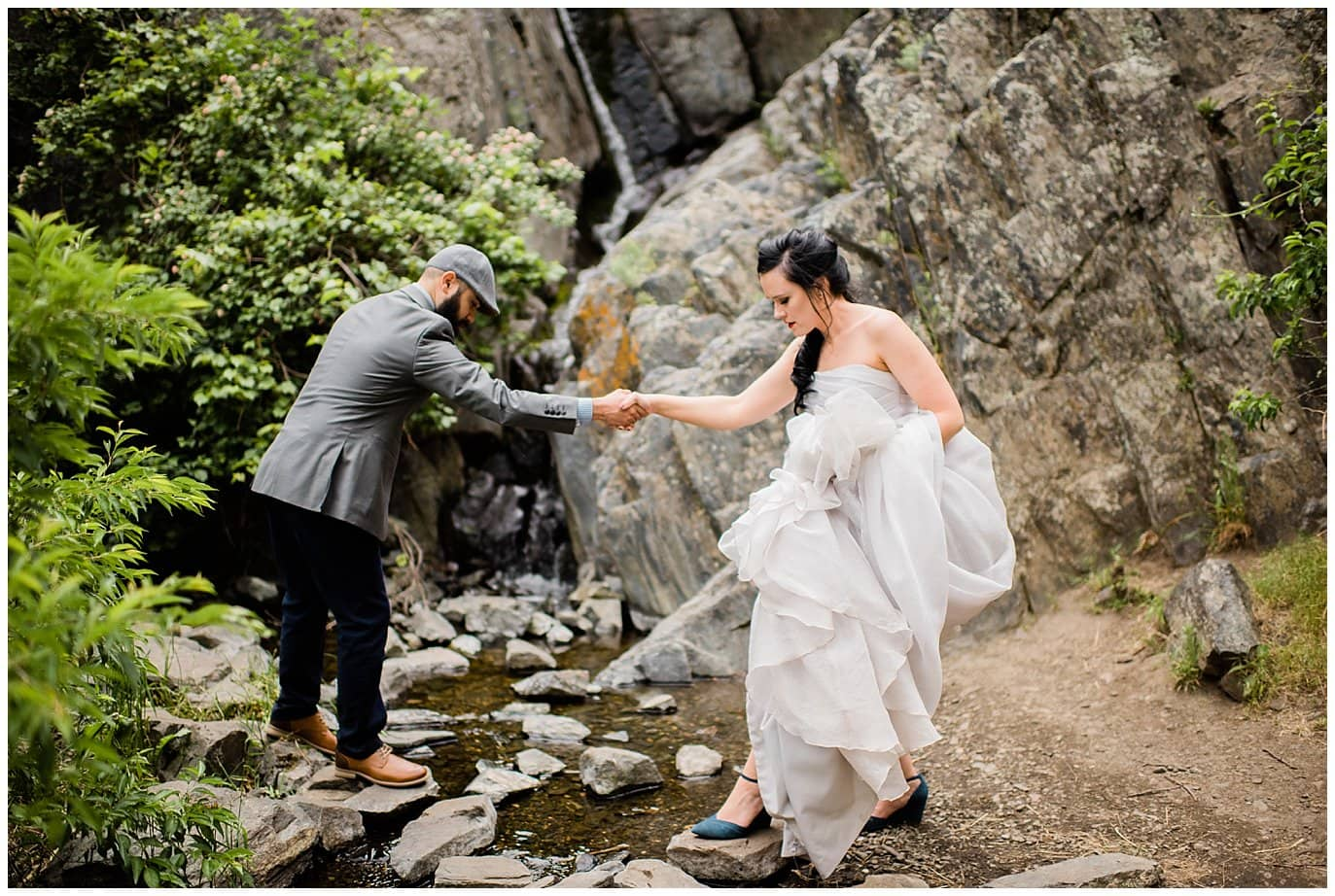 bride crossing rocks on stream colorado wedding photo