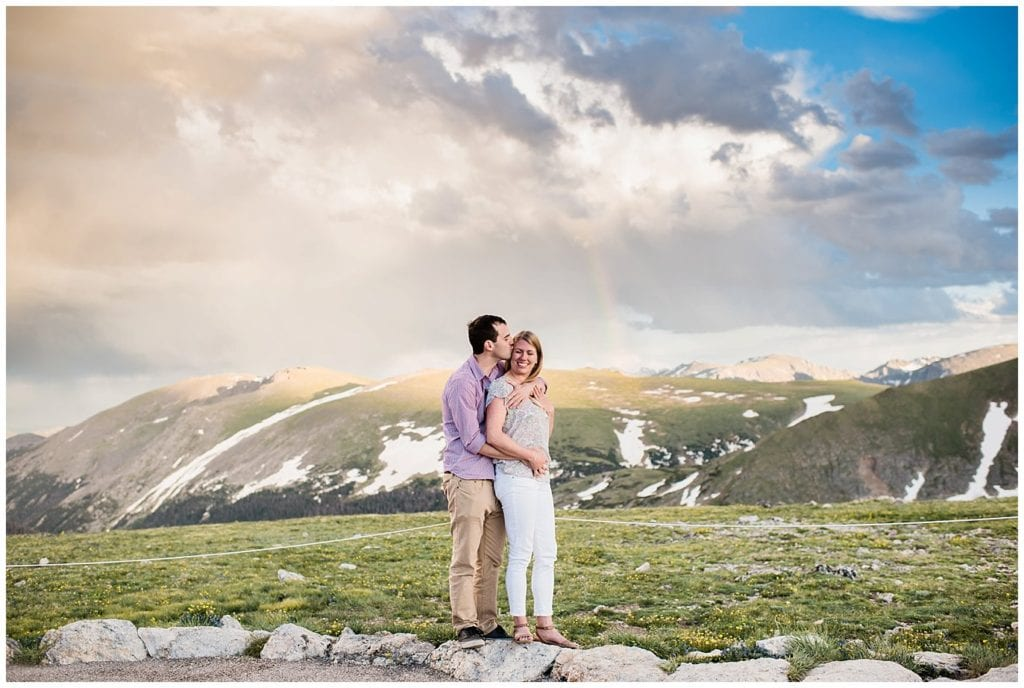 sunset and rainbows in RMNP engagement at top of Trail Ridge Road by Estes Park wedding photographer Jennie Crate