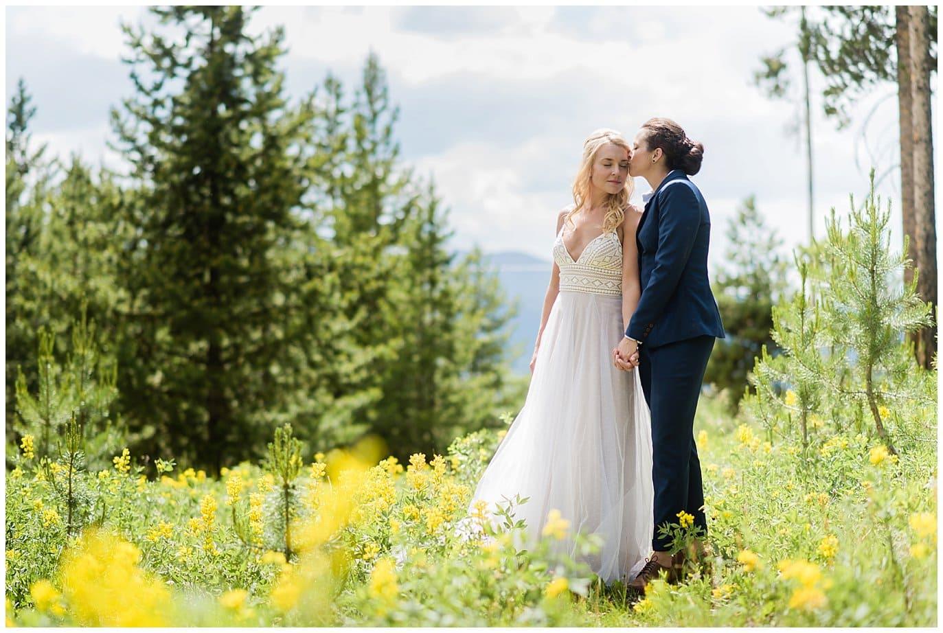two brides in field of wild flowers Winter Park wedding photo