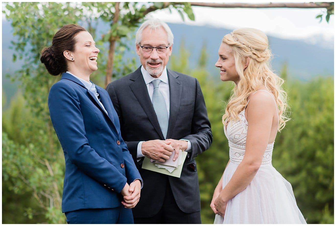 laughing at Colorado Winter Park wedding photo