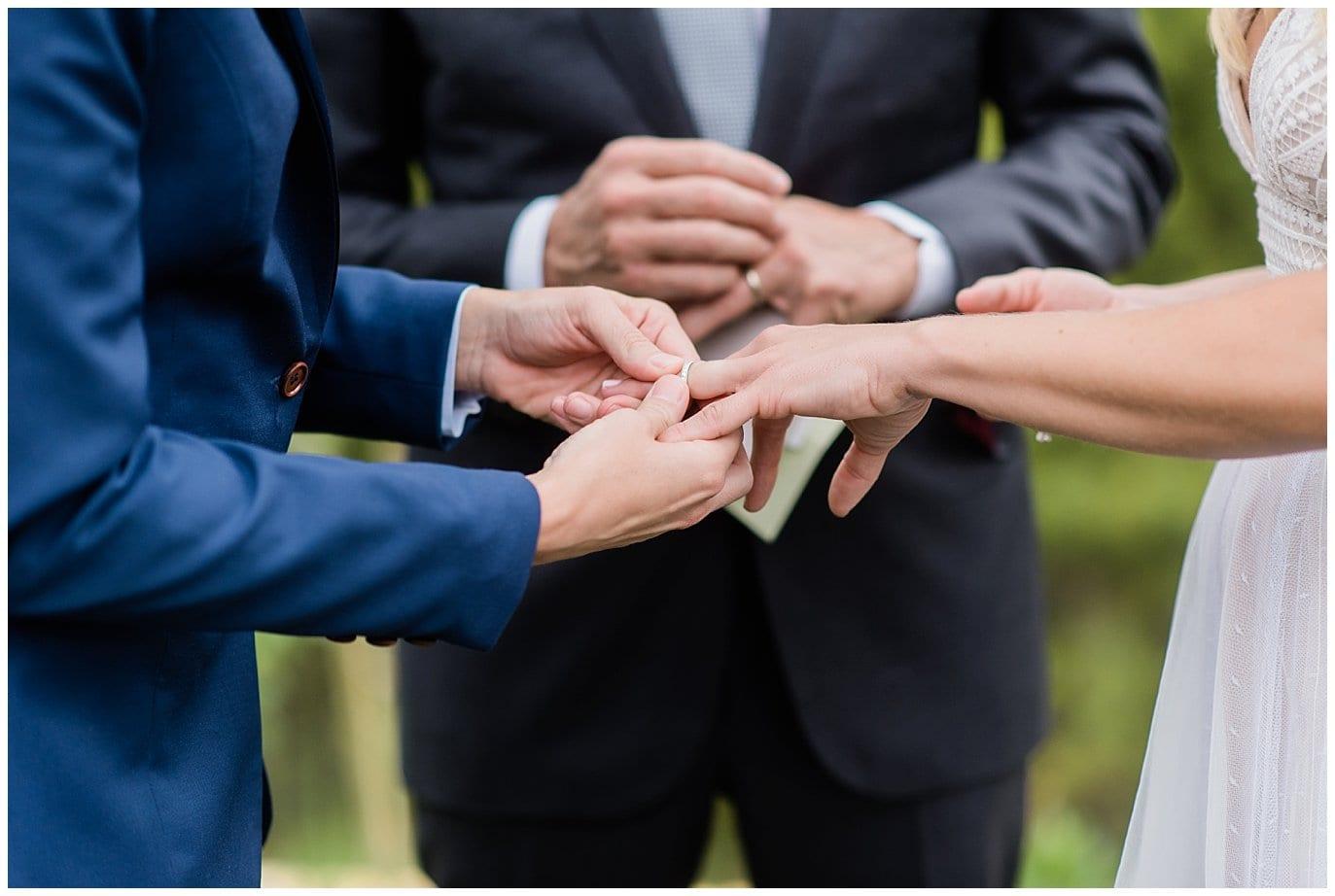 ring exchange Colorado mountain wedding photo