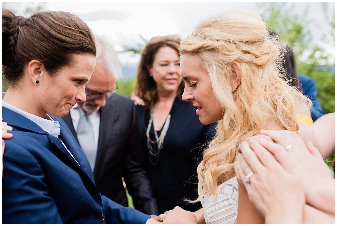 group prayer intimate Colorado wedding photo