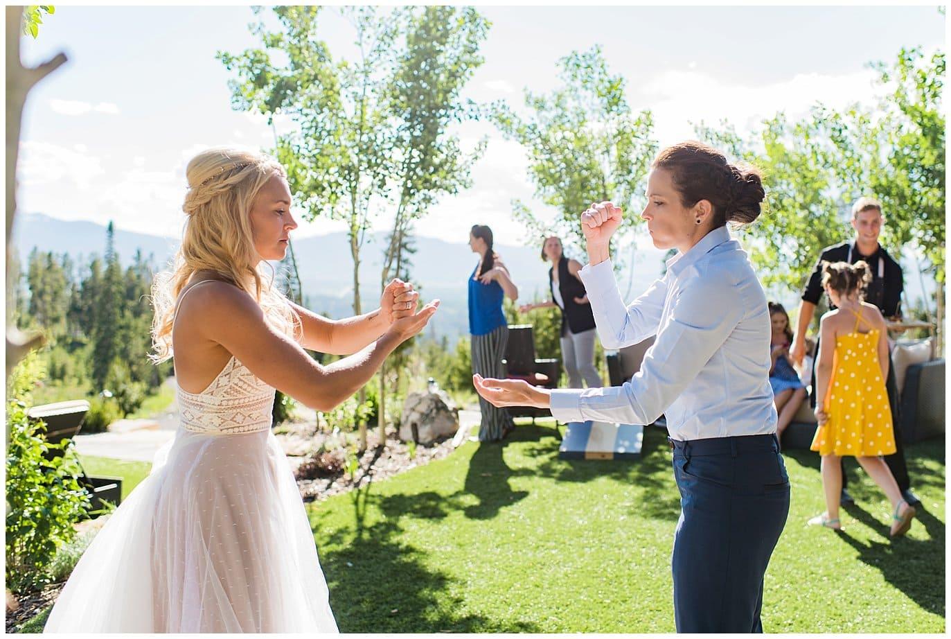 rock paper scissor for yard games at wedding photo