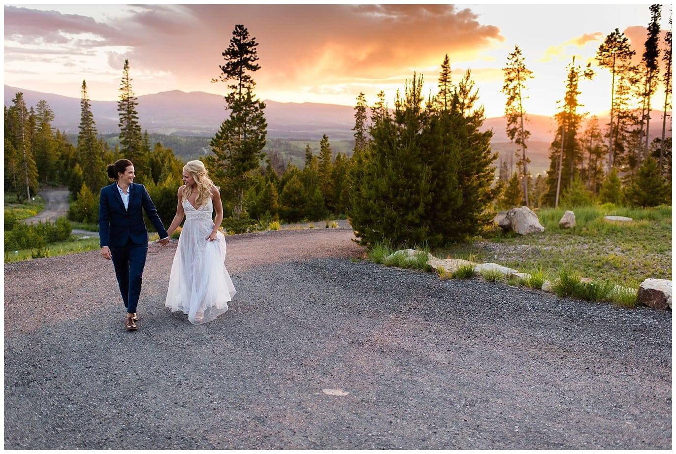 Brides walking at sunset Winter Park Colorado wedding photo