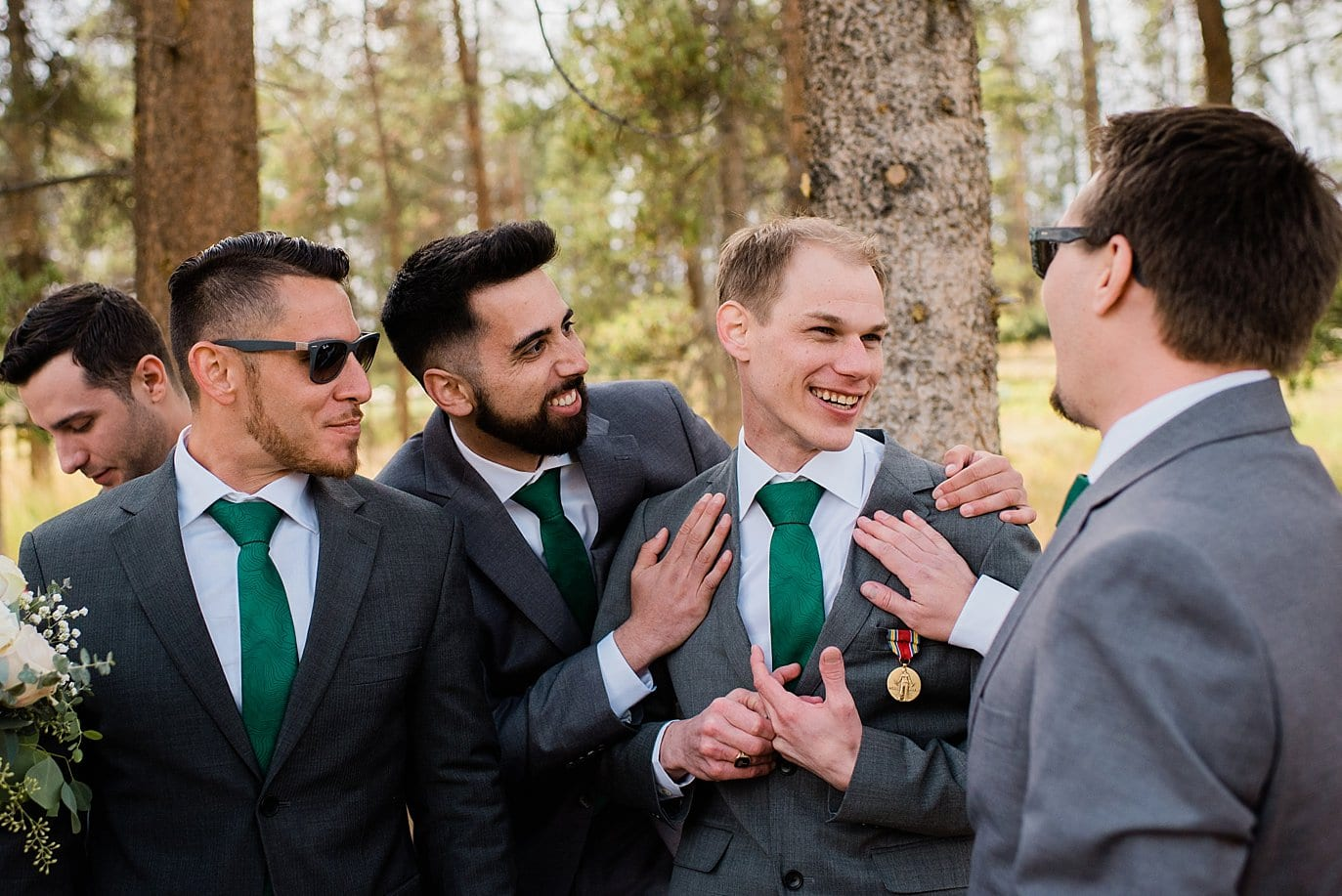 groom celebrates marriage with groomsmen at B Lazy 2 Ranch wedding by Winter Park wedding photographer Jennie Crate