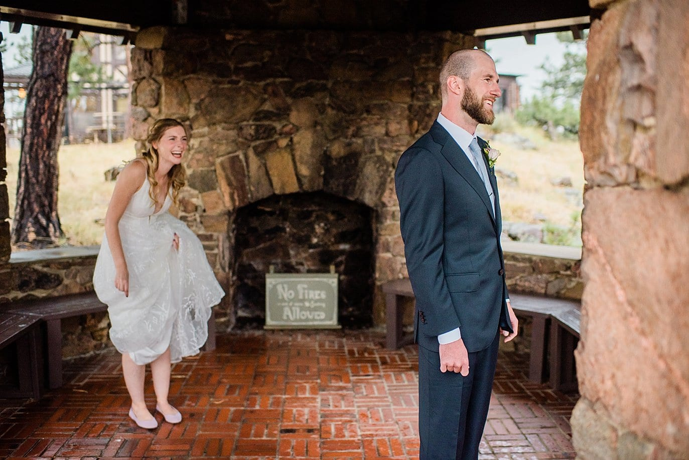 rainy first look in stone gazebo at Golden colorado wedding