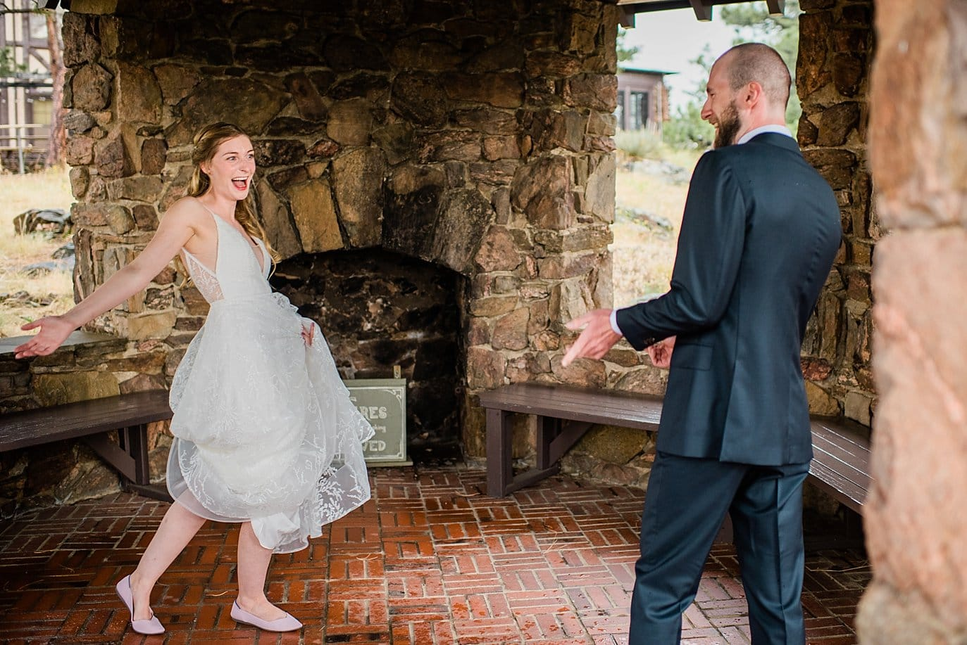 bride and groom excited for first look in stone gazebo