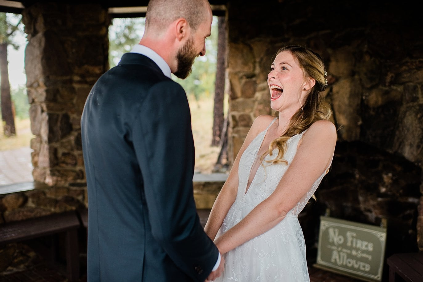 bride excited for first look at Boettcher Mansion wedding