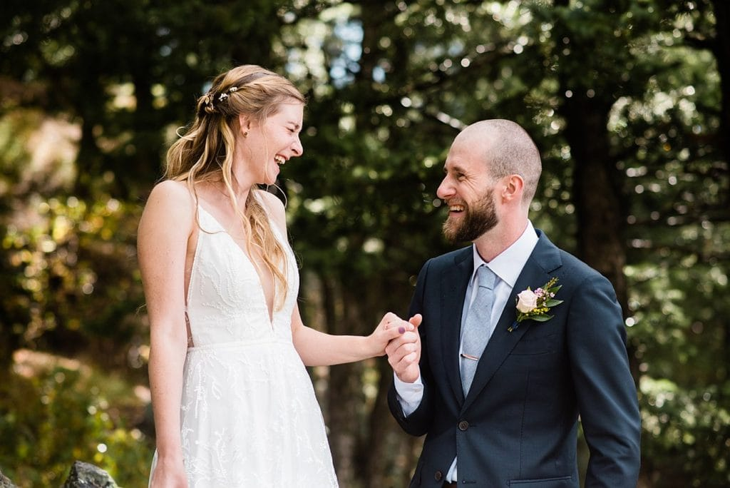 laughing bride and groom at Boettcher Mansion summer wedding by Breckenridge Wedding Photographer Jennie Crate, Photographer