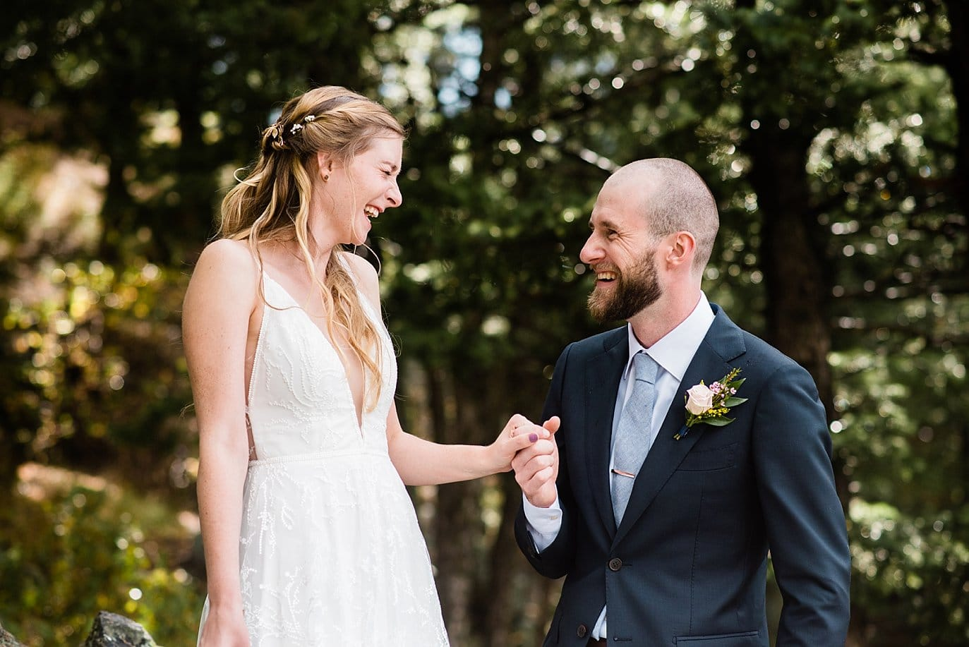 laughing bride and groom at Boettcher Mansion summer wedding
