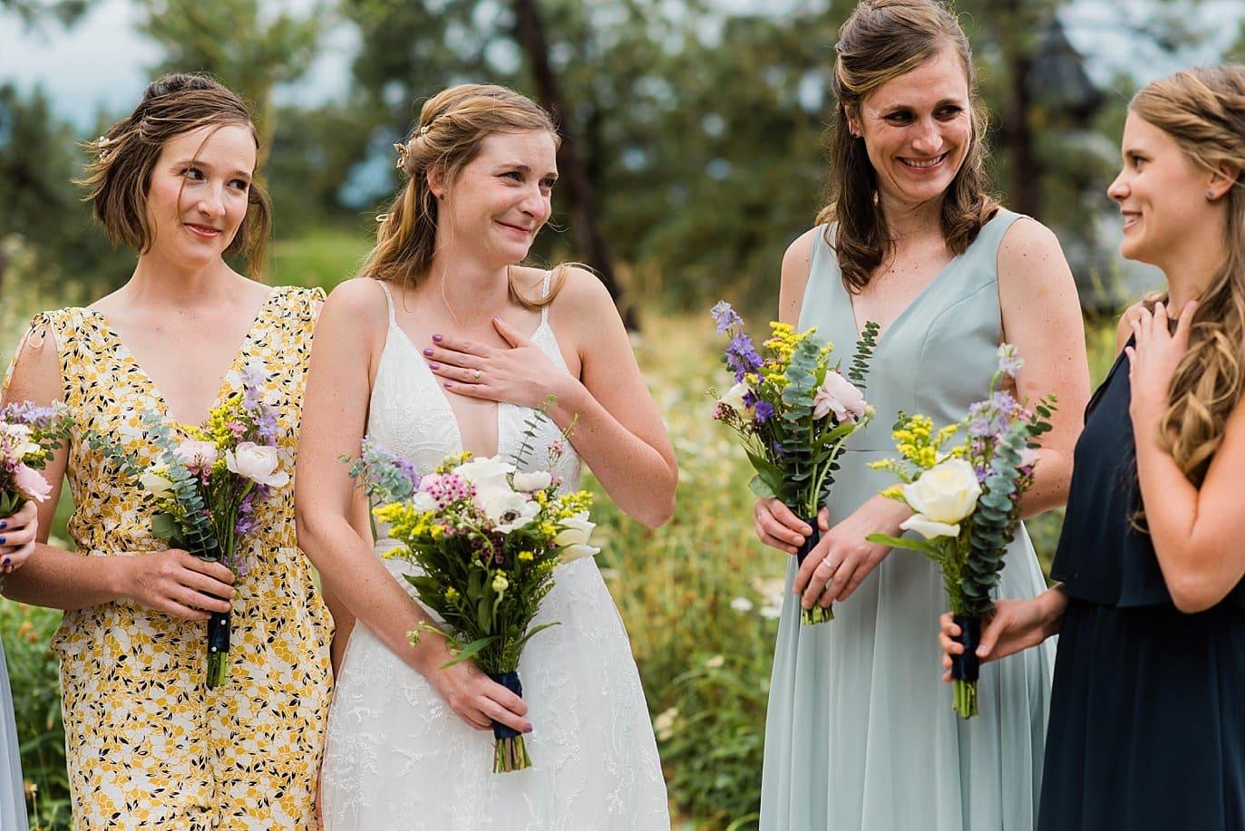 bride and bridesmaid sharing emotional stories at historic house wedding