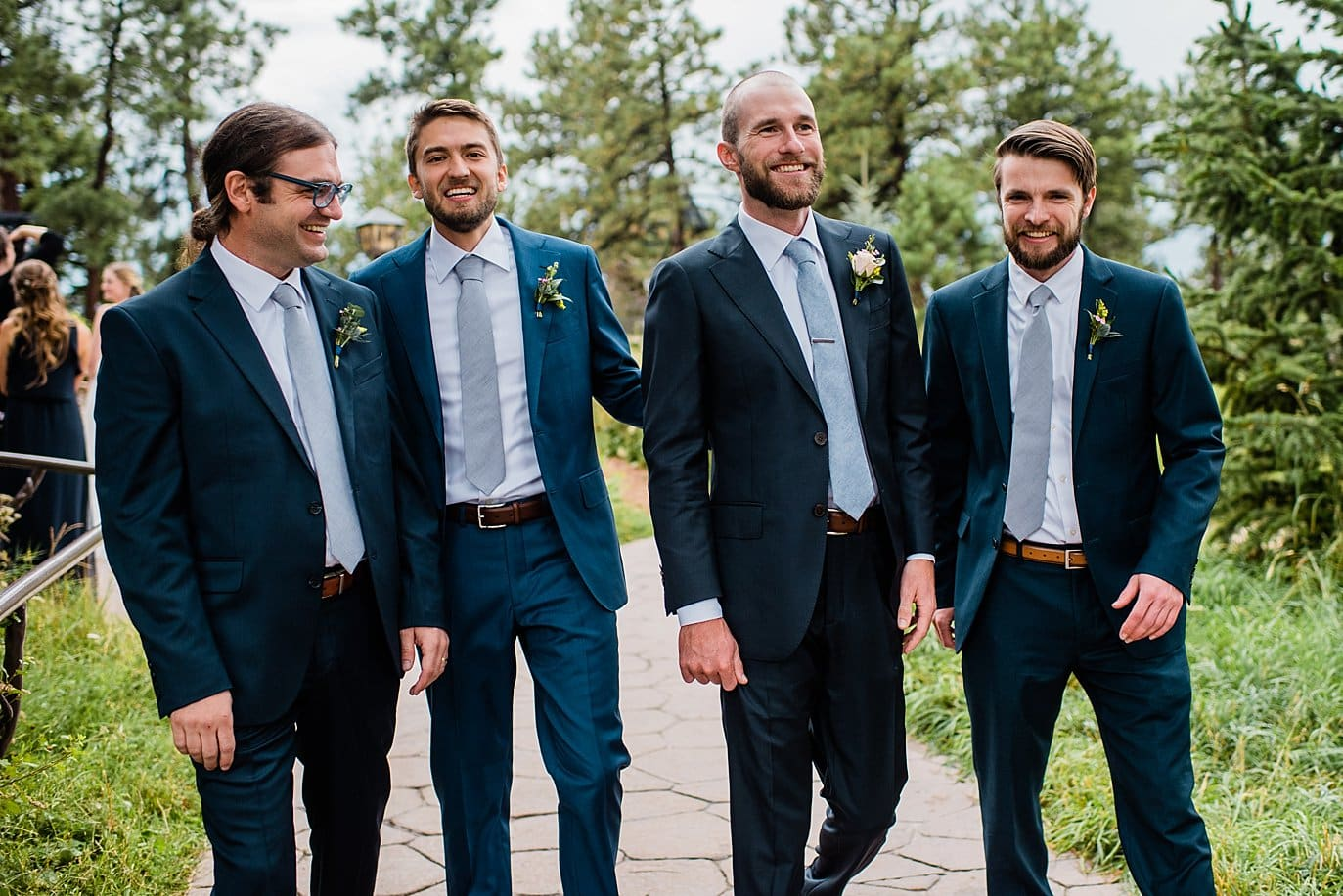 groom and groomsmen in mismatched navy blue suits and periwinkle ties