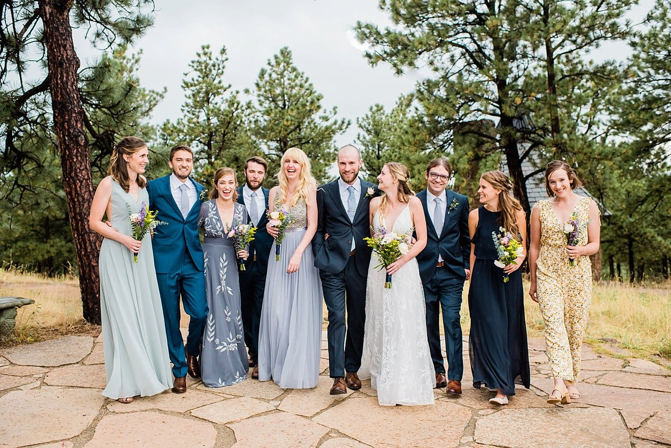 blue green and navy bridal party at romantic golden wedding