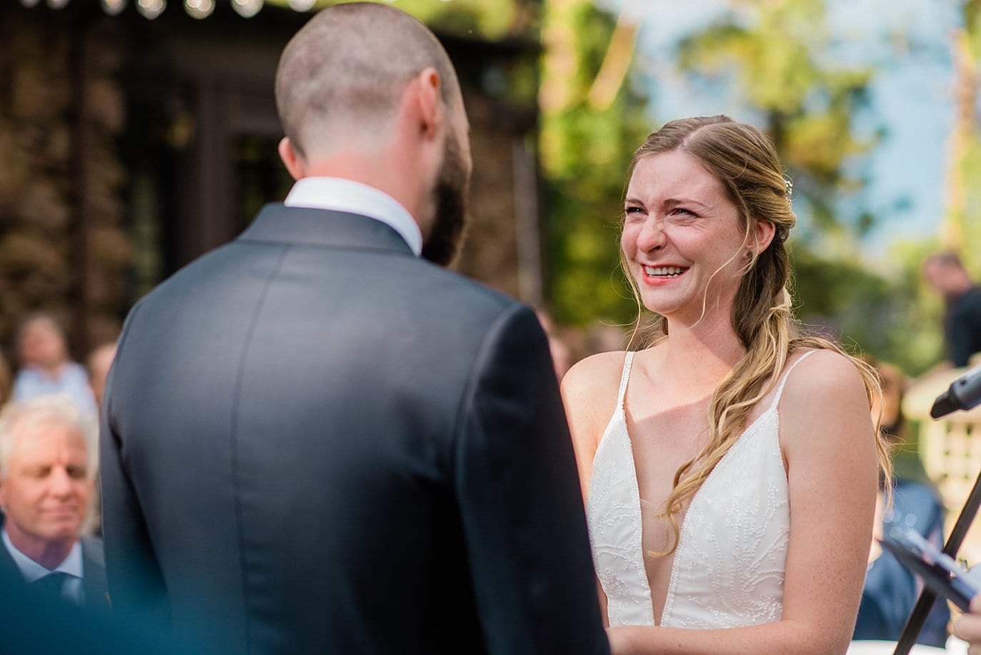 emotional vows during outdoor historic mansion wedding