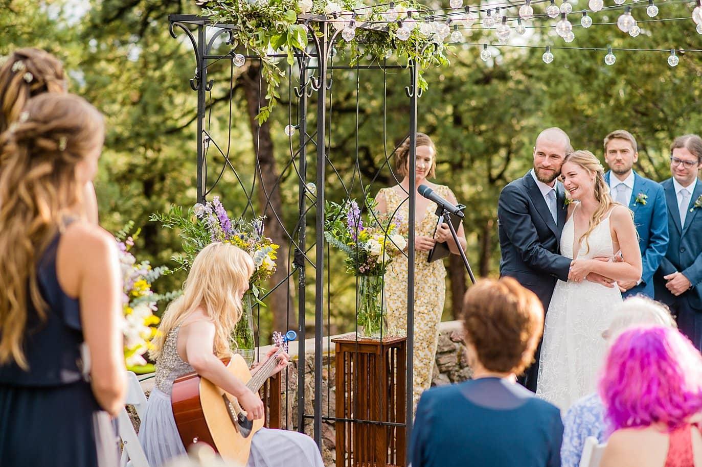 bridemaid plays guitar and sings during outdoor colorado wedding