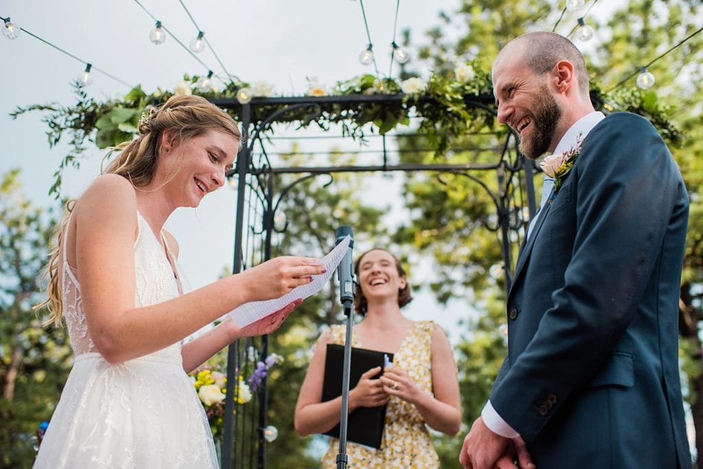 emotional vows on outdoor patio at romantic golden wedding by Evergreen Wedding photographer Jennie Crate