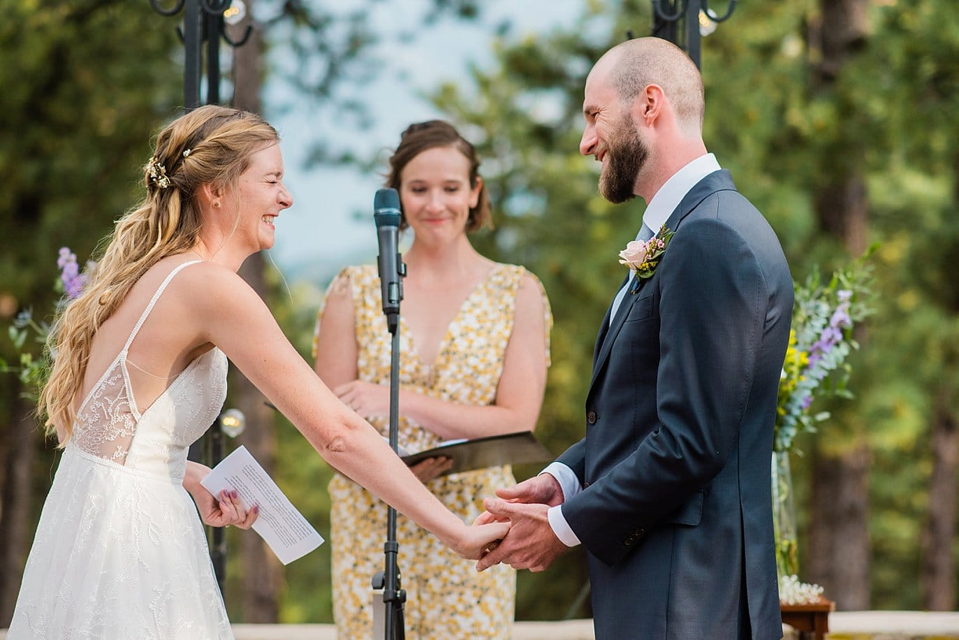 bride and groom laughing during vows on boettcher mansion patio