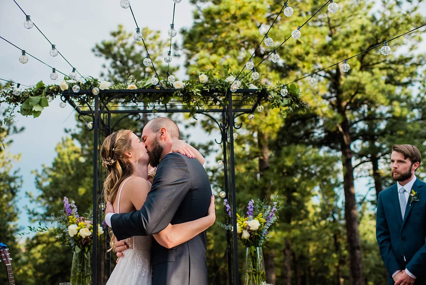 first kiss on outdoor patio with market light