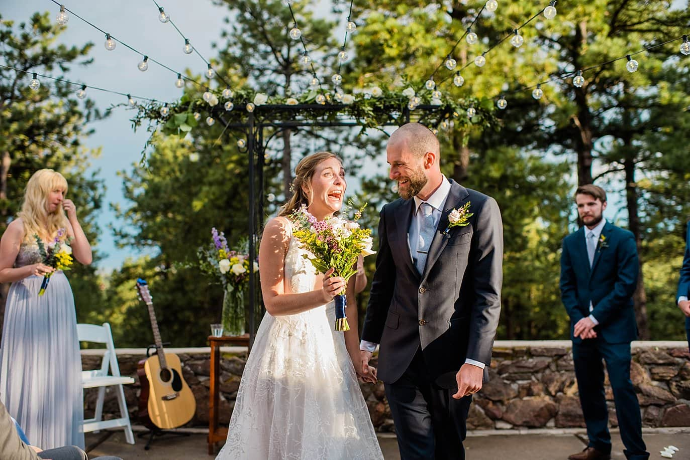 bride and groom walk down the aisle after first kiss outdoor colorado wedding