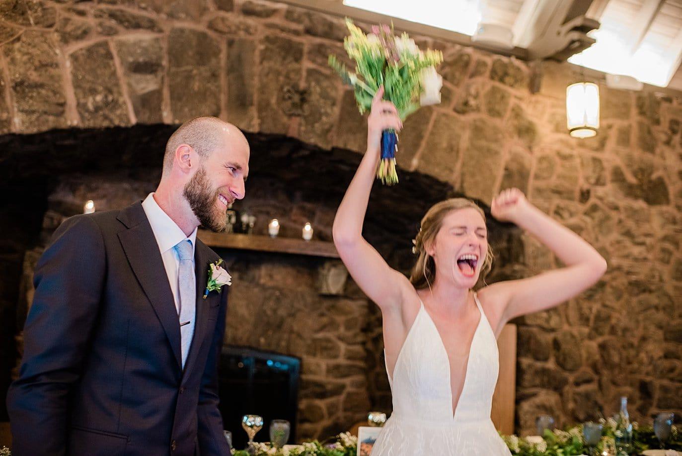 bride celebrates after ceremony at colorado wedding