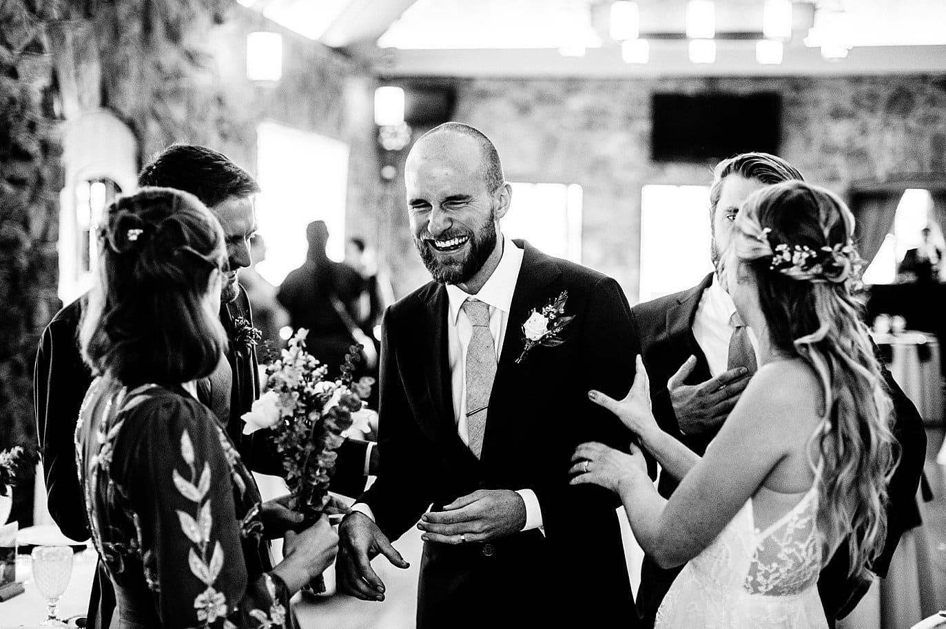 groom and bridesmaids celebrate after colorado outdoor wedding