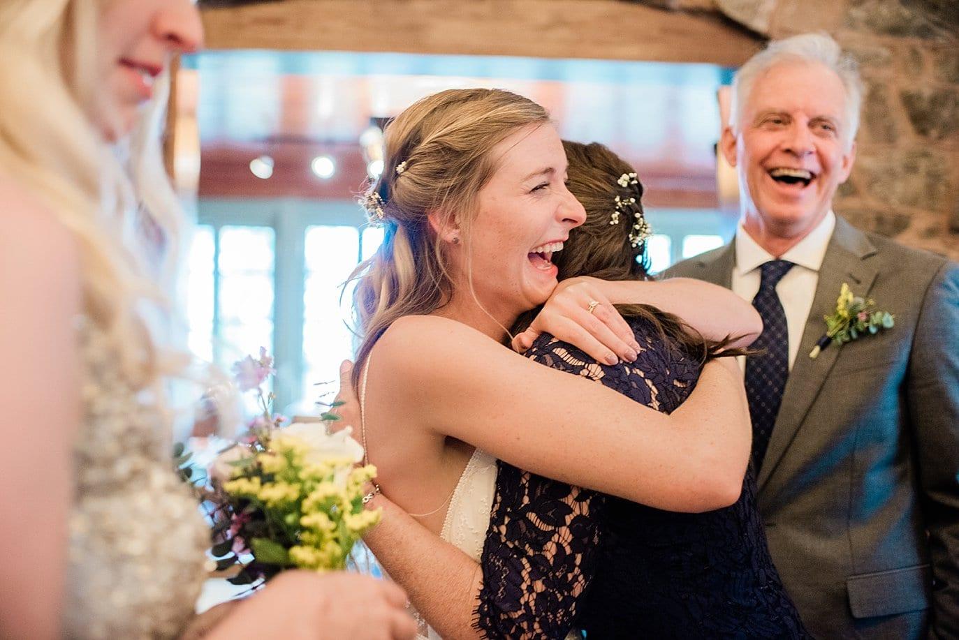 bride hugs mom after wedding ceremony