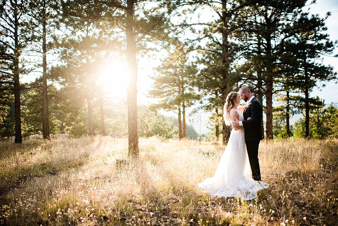 intimate sunset photo of bride and groom in the evergreen trees at Boettcher Mansion
