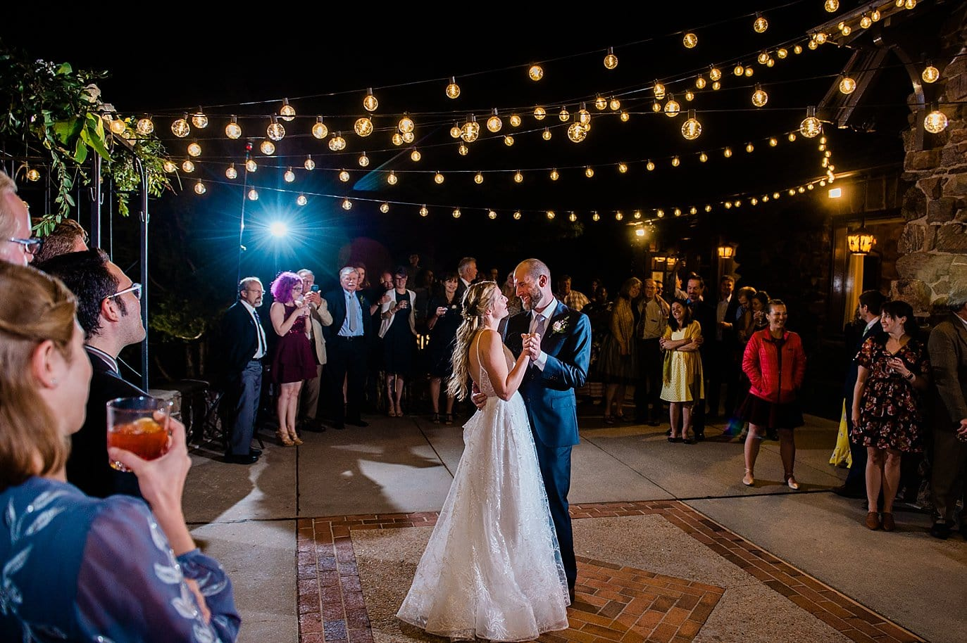first dance on outdoor patio under market lights in golden colorado wedding
