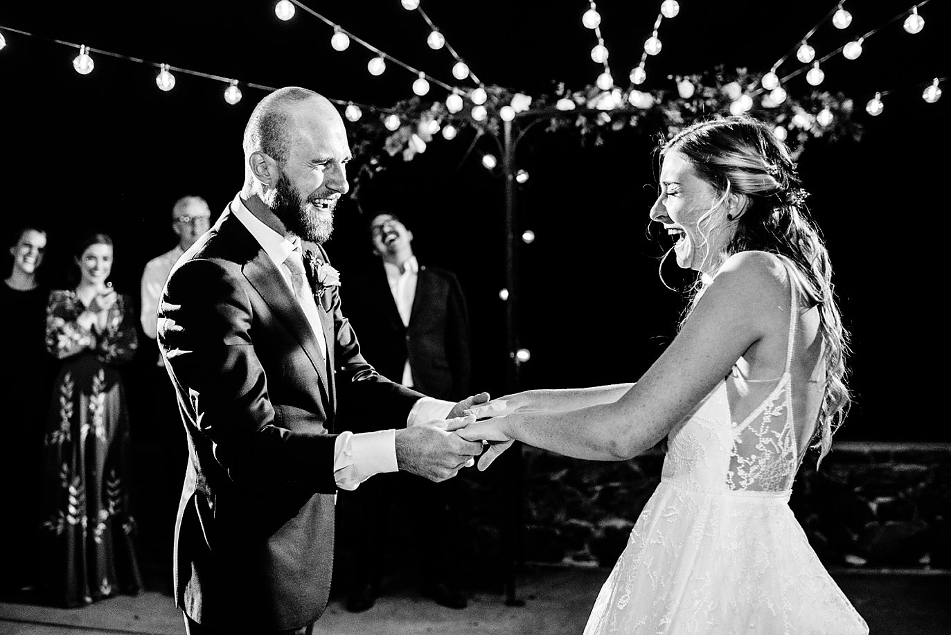 bride and groom first dance at Boettcher Mansion wedding outdoor patio with market lights