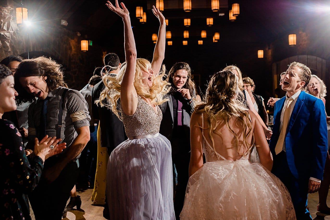 cheering bridesmaid during dancing at historic colorado mansion wedding