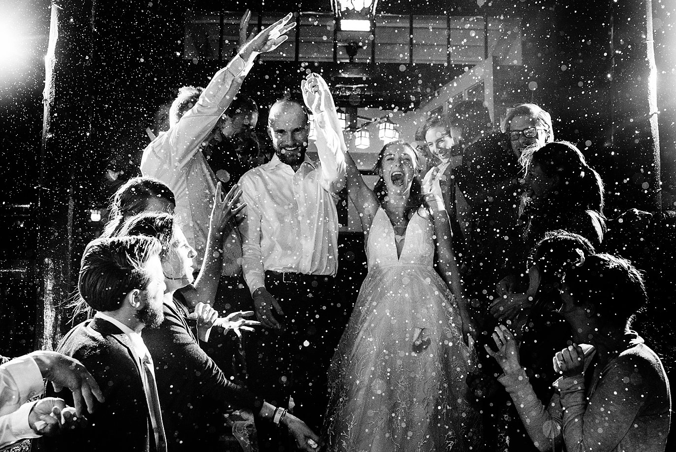 bride and groom grand exit the ceremony at the rainy boettcher mansion wedding