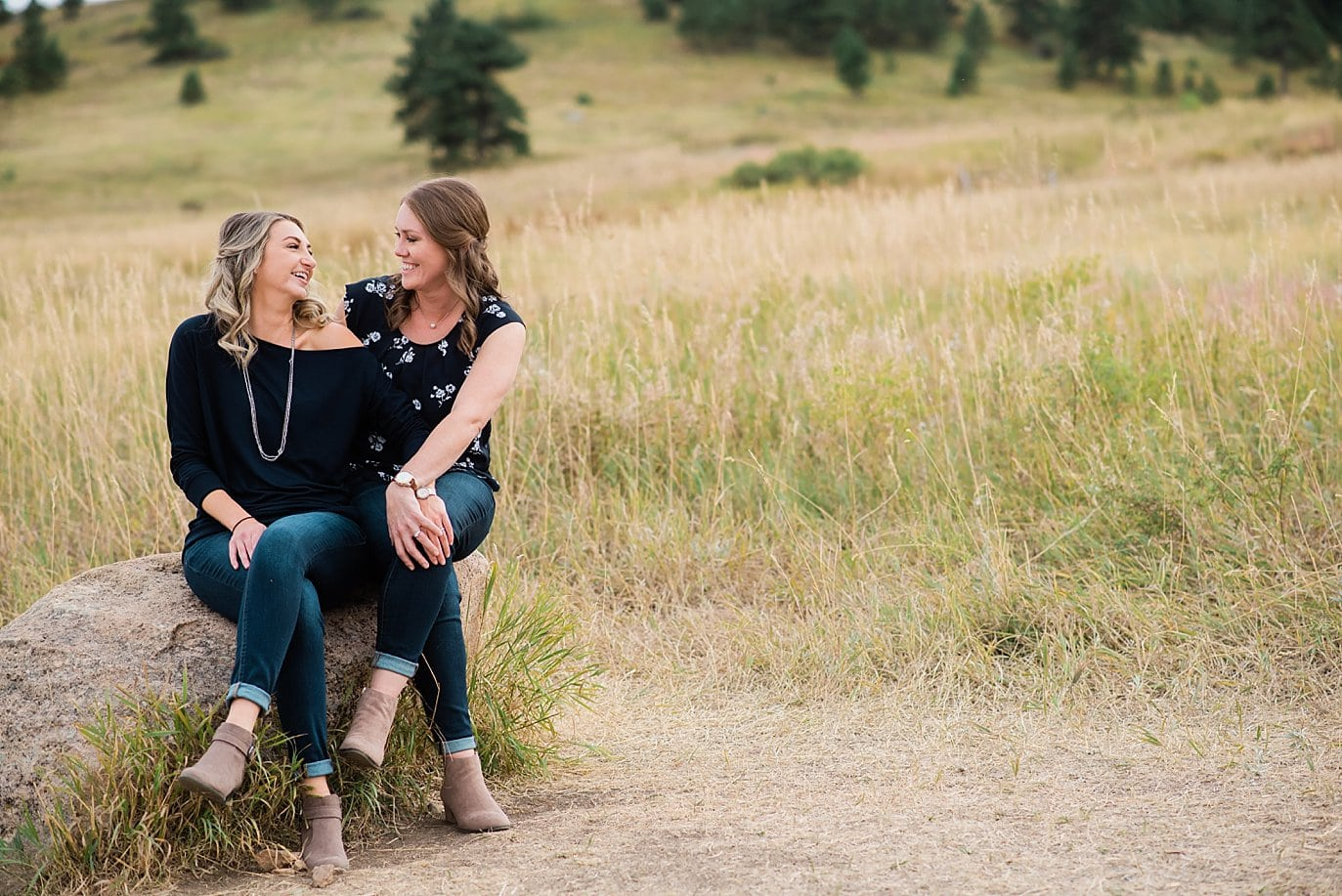 two women laughing at Chautaqua Park engagement by Denver engagement photographer Jennie Crate