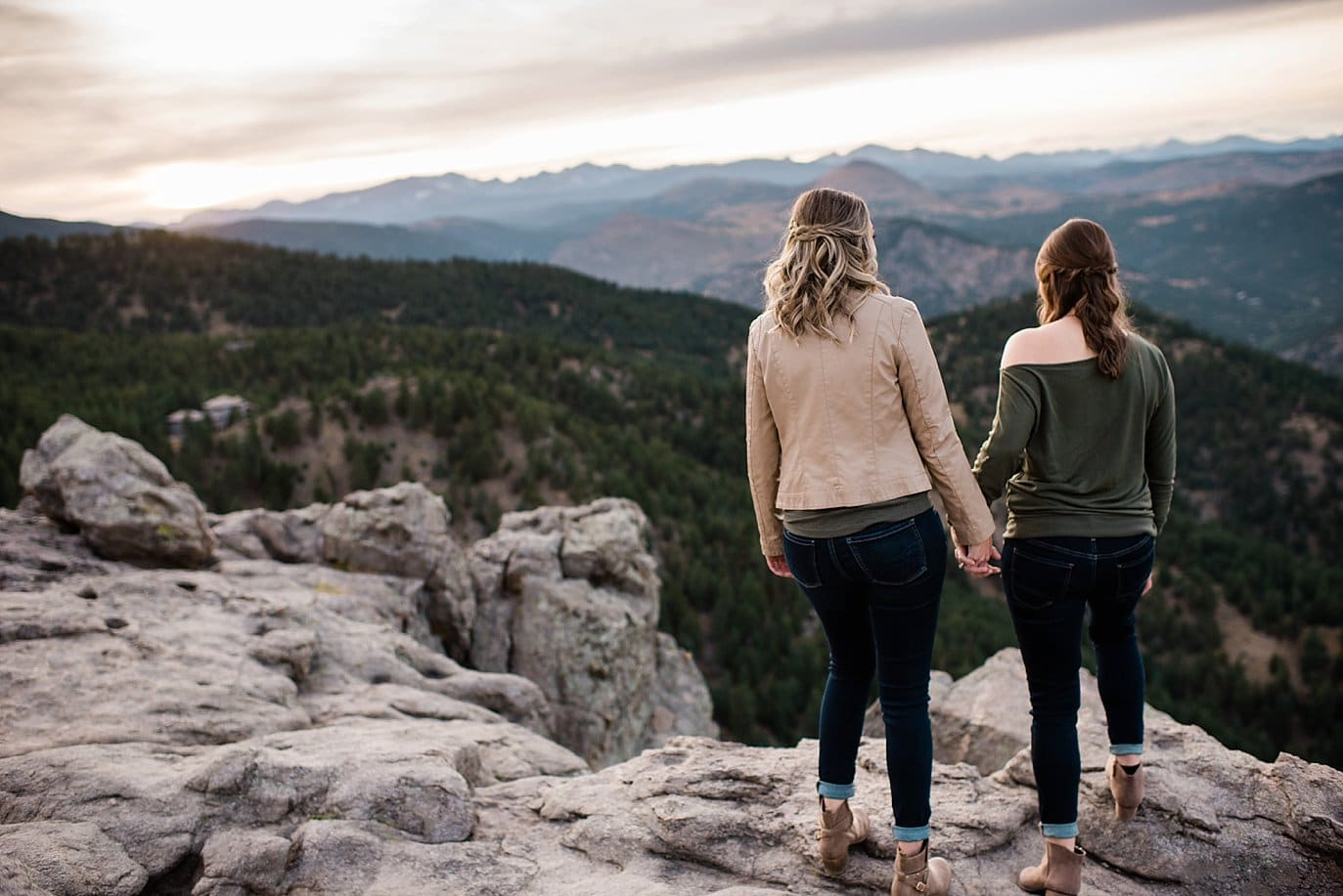 queer couple holding hands at top of Lost Gulch Lookout by Boulder wedding photographer Jennie Crate