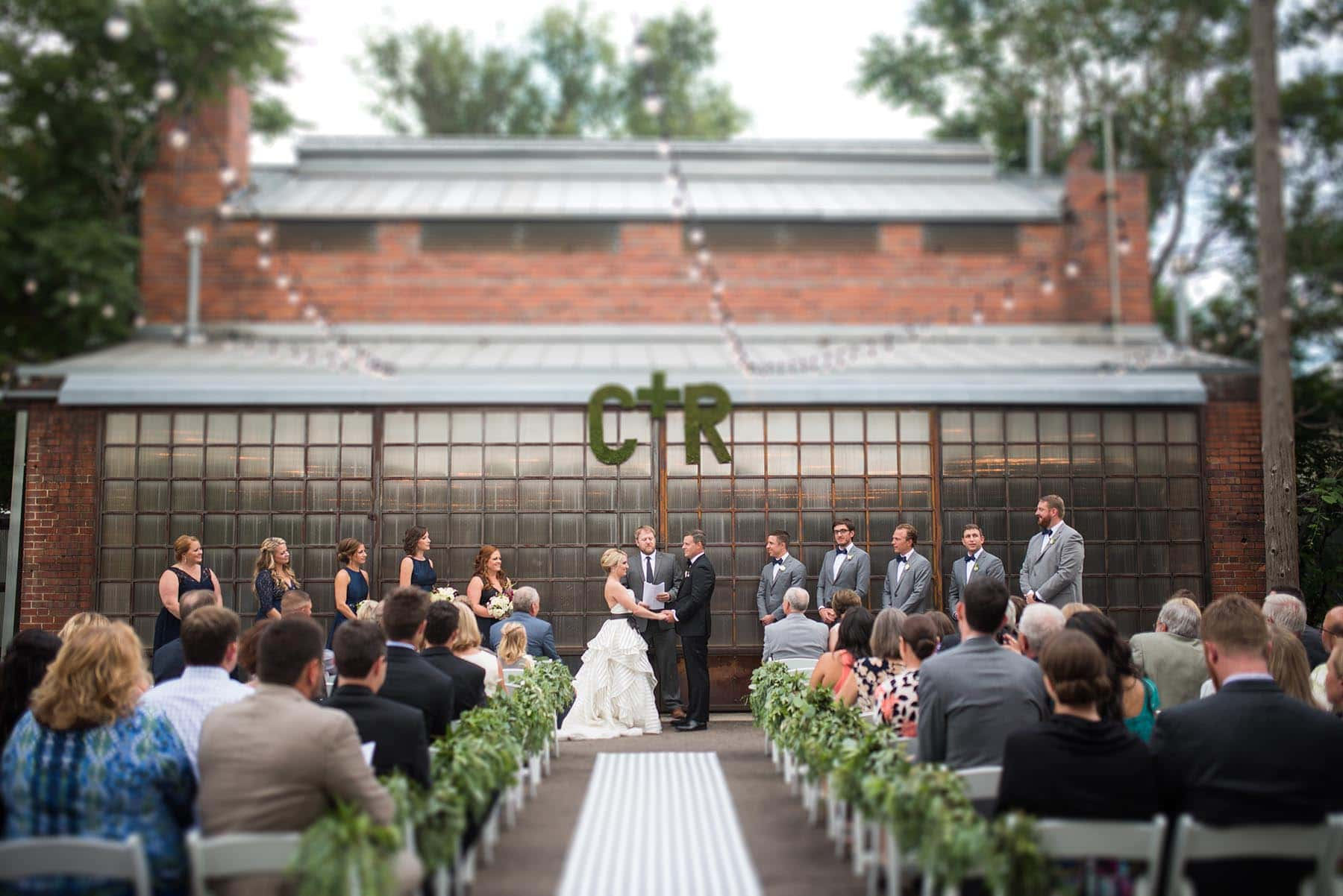 bride and groom on outdoor plaza at blanc Denver wedding by Denver Wedding Photographer Jennie Crate, Photographer