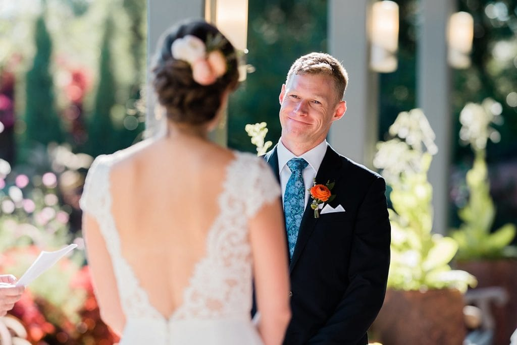 groom looking at bride during Annuals garden ceremony Insert text here