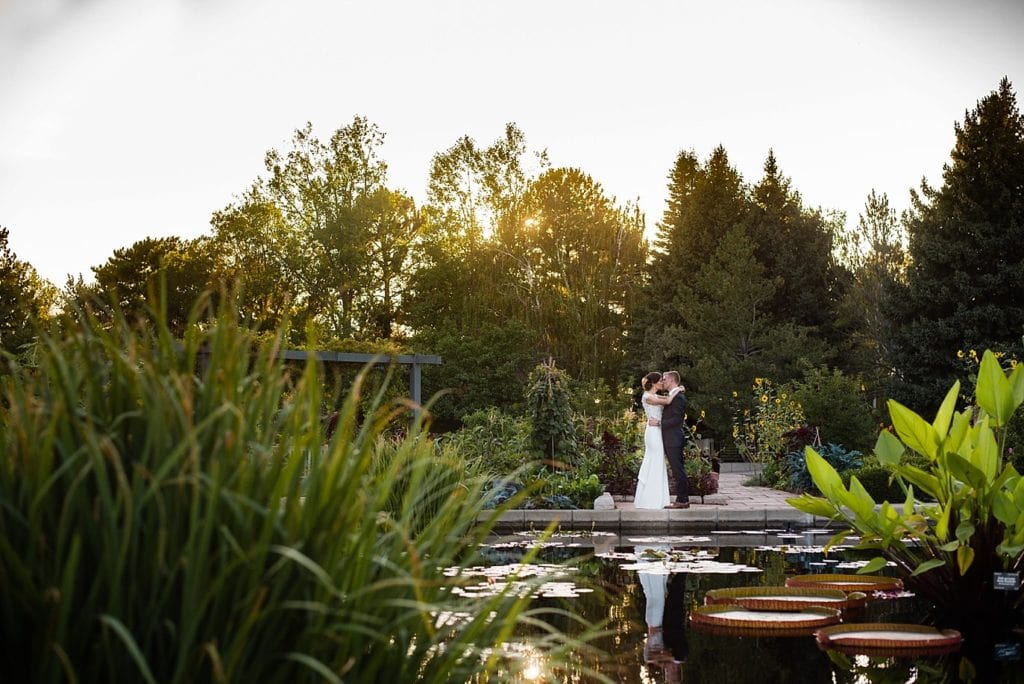 bride and groom at sunset at Monet's Pond at Denver Botanic Gardens wedding by Denver Wedding Photographer Jennie Crate