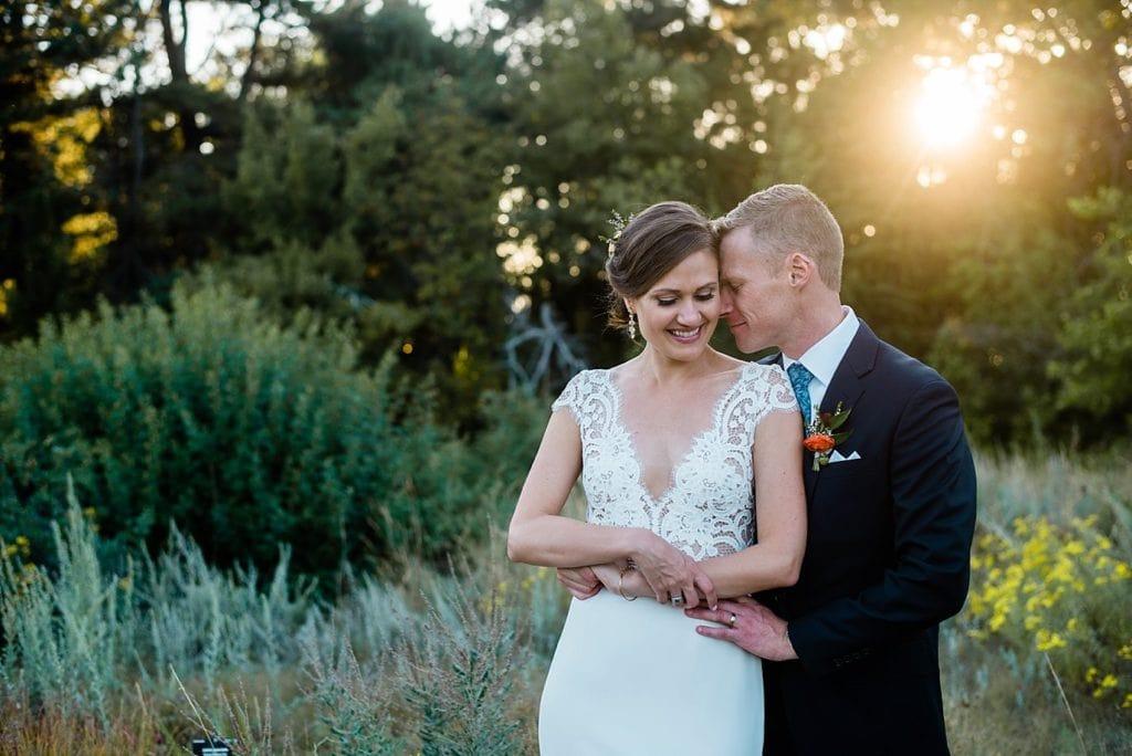 bride and groom at sunset at Denver Botanic Gardens wedding by Denver Wedding Photographer Jennie Crate