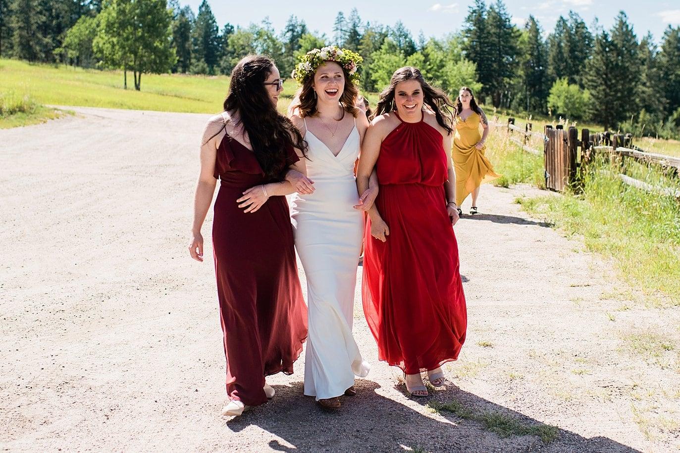 bride and bridesmaids walking to ceremony colorado outdoor wedding photo