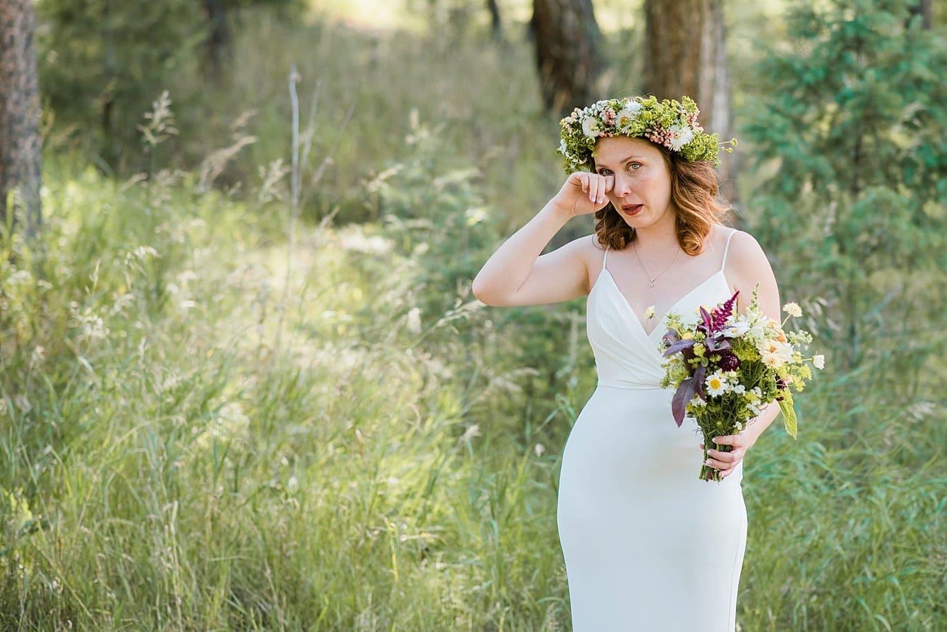emotional bride in BHLDN wedding dress photo
