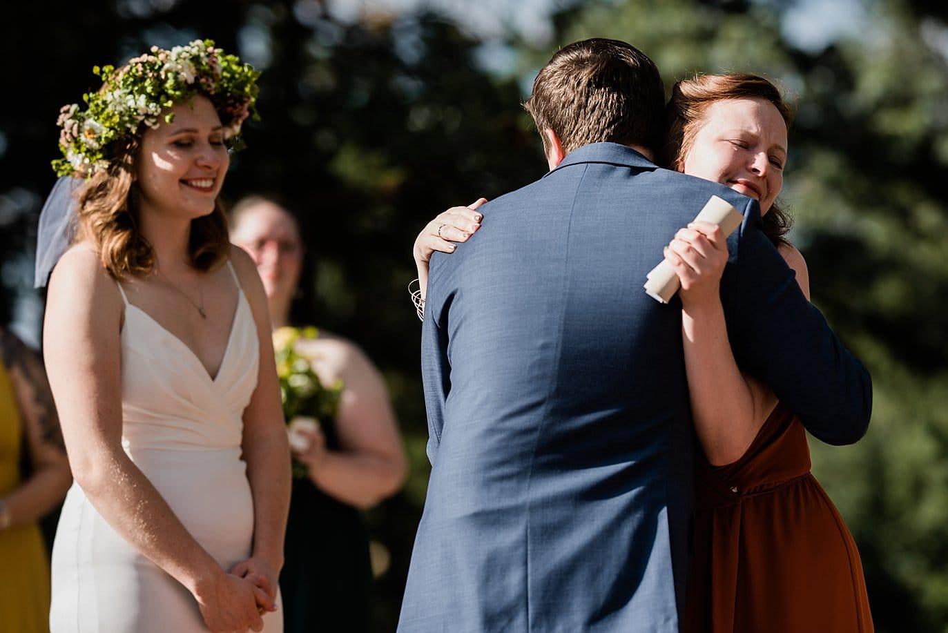 emotional hugs at outdoor Colorado wedding photo