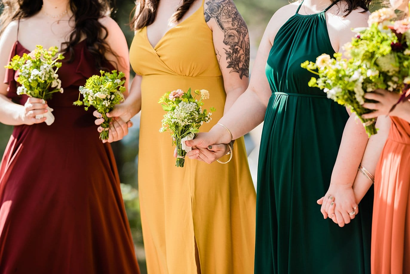 bridesmaids holding hands during intimate wedding ceremony photo
